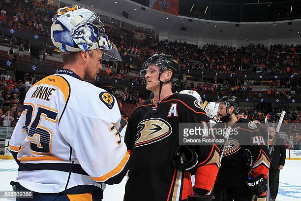 Pekka Rinne of the Nashville Predators and Corey Perry of the Anaheim Ducks shake hands after Game Seven of the Western Conference First Round during...