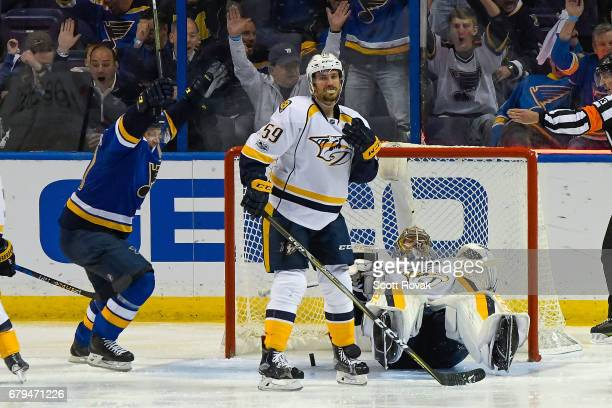 Pekka Rinne of the Nashville Predators and Roman Josi of the Nashville Predators react as Vladimir Tarasenko of the St Louis Blues celebrates a St...