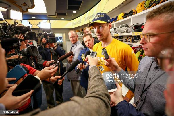 Pekka Rinne of the Nashville Predators answers questions from the media following a 41 win against the Dallas Stars during an NHL game at Bridgestone...