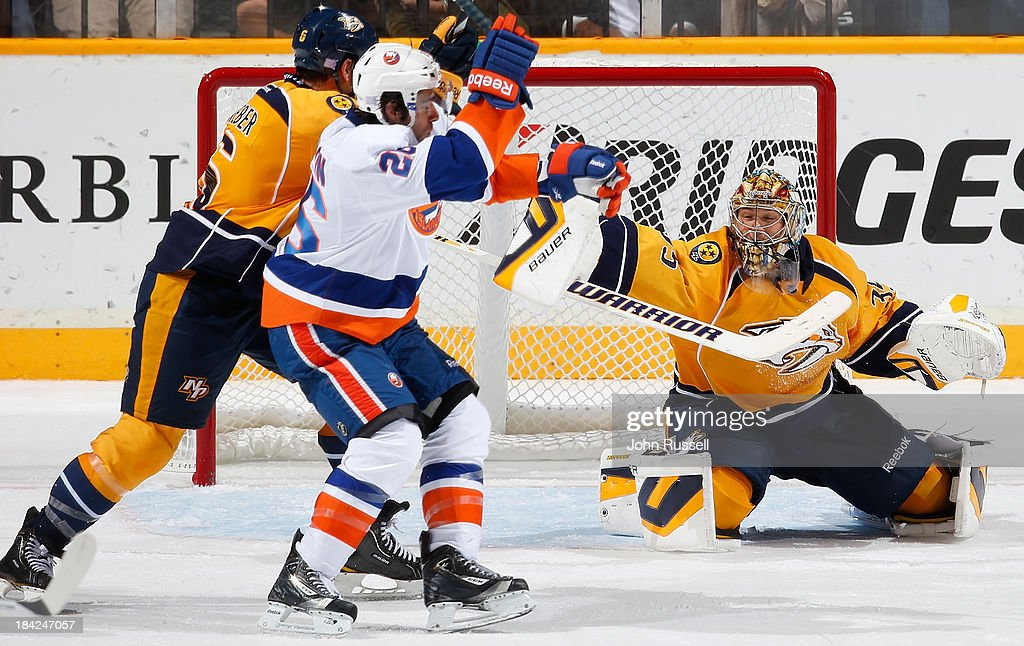 <a gi-track='captionPersonalityLinkClicked' href=/galleries/search?phrase=Pekka+Rinne&family=editorial&specificpeople=2118342 ng-click='$event.stopPropagation()'>Pekka Rinne</a> #35 of the Nashville Predators blocks a shot against <a gi-track='captionPersonalityLinkClicked' href=/galleries/search?phrase=Matt+Moulson&family=editorial&specificpeople=3365493 ng-click='$event.stopPropagation()'>Matt Moulson</a> #26 of the New York Islanders at Bridgestone Arena on October 12, 2013 in Nashville, Tennessee.