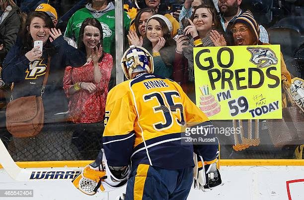 Pekka Rinne of the Nashville Predators catches the eyes of lady fans as he warmsup against the Winnipeg Jets during an NHL game at Bridgestone Arena...