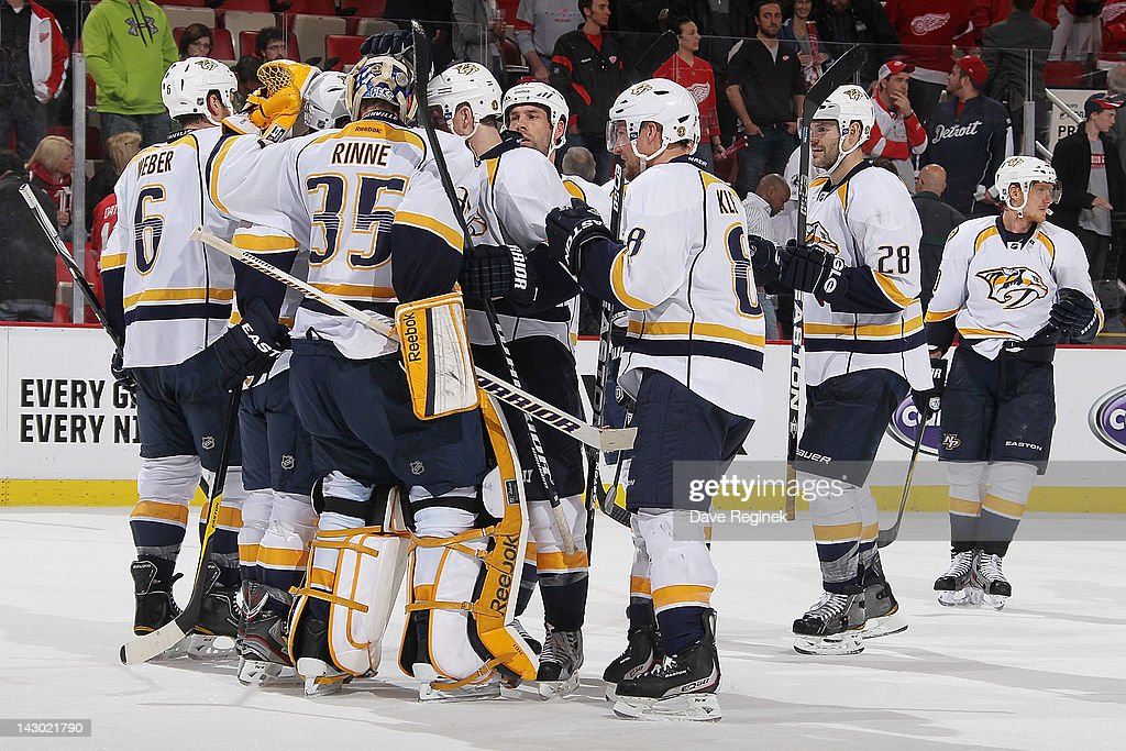 <a gi-track='captionPersonalityLinkClicked' href=/galleries/search?phrase=Pekka+Rinne&family=editorial&specificpeople=2118342 ng-click='$event.stopPropagation()'>Pekka Rinne</a> #35 of the Nashville Predators celebrates a victory with teammates after Game Four of the Western Conference Quarterfinals against the Detroit Red Wings during the 2012 NHL Stanley Cup Playoffs at Joe Louis Arena on April 17, 2012 in Detroit, Michigan. Nashville won 3-1 leading the series 3-1.