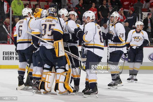 Pekka Rinne of the Nashville Predators celebrates a victory with teammates after Game Four of the Western Conference Quarterfinals against the...