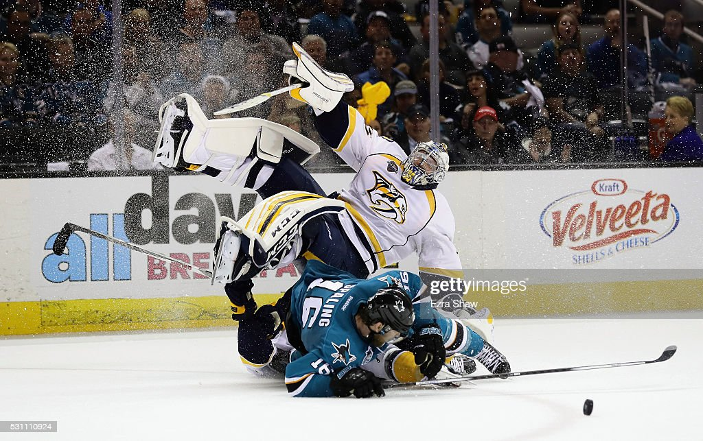 Pekka Rinne of the Nashville Predators collides with Nick Spaling of the San Jose Sharks in the second period of Game Seven of the Western Conference...