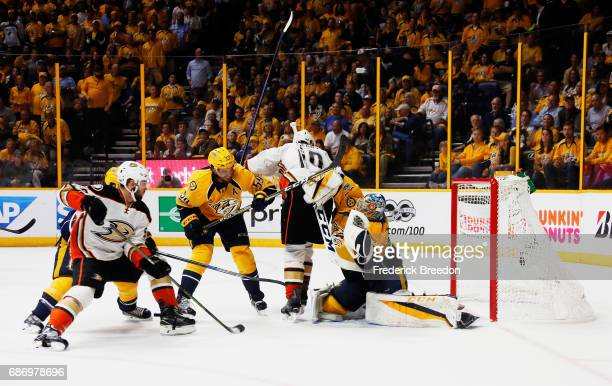 Pekka Rinne of the Nashville Predators defends against Nic Kerdiles of the Anaheim Ducks during the second period in Game Six of the Western...