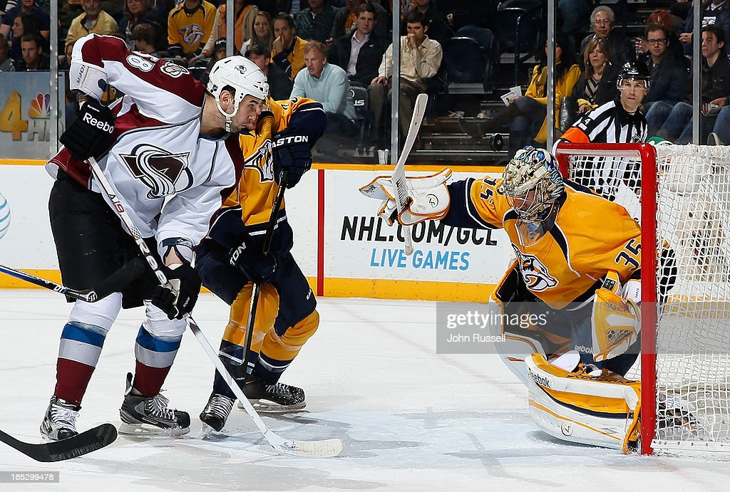 <a gi-track='captionPersonalityLinkClicked' href=/galleries/search?phrase=Pekka+Rinne&family=editorial&specificpeople=2118342 ng-click='$event.stopPropagation()'>Pekka Rinne</a> #35 of the Nashville Predators deflects a shot against Patrick Bordeleau #58 of the Colorado Avalanche during an NHL game at the Bridgestone Arena on April 2, 2013 in Nashville, Tennessee.