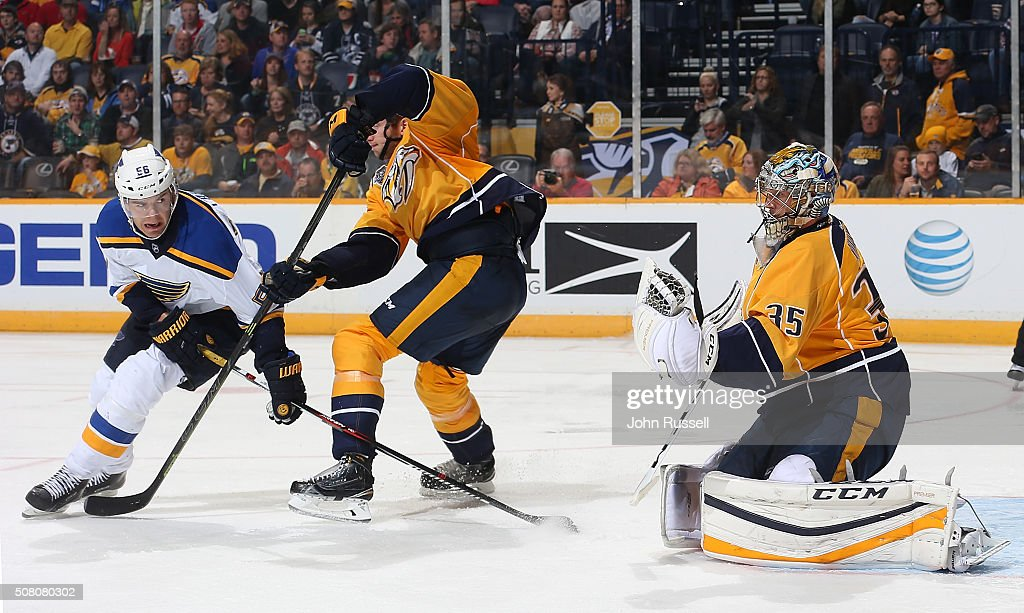 Pekka Rinne of the Nashville Predators gloves a shot against Magnus Paajarvi of the St Louis Blues during an NHL game at Bridgestone Arena on...