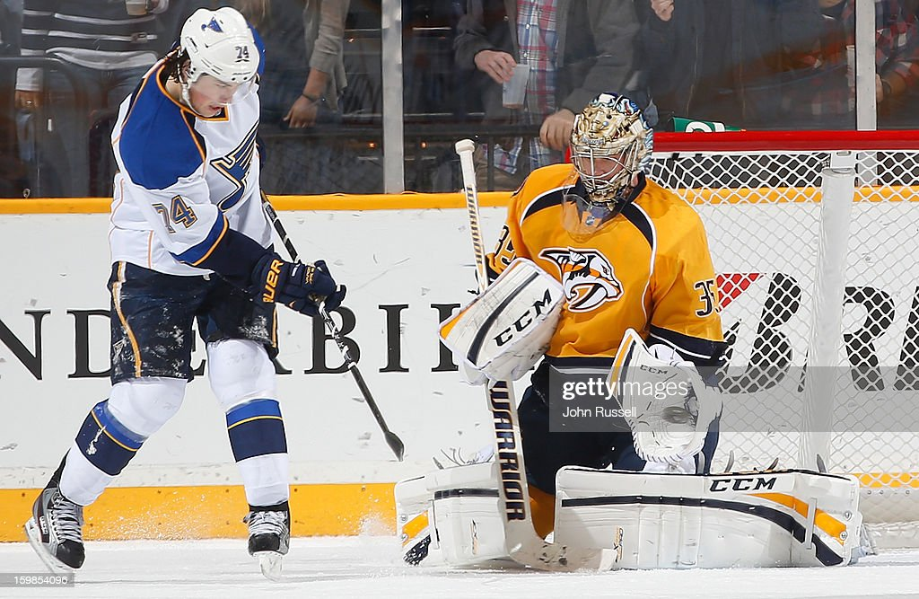 <a gi-track='captionPersonalityLinkClicked' href=/galleries/search?phrase=Pekka+Rinne&family=editorial&specificpeople=2118342 ng-click='$event.stopPropagation()'>Pekka Rinne</a> #35 of the Nashville Predators gloves a shot against <a gi-track='captionPersonalityLinkClicked' href=/galleries/search?phrase=T.J.+Oshie&family=editorial&specificpeople=700383 ng-click='$event.stopPropagation()'>T.J. Oshie</a> #74 of the St. Louis Blues during an NHL game at the Bridgestone Arena on January 21, 2013 in Nashville, Tennessee.