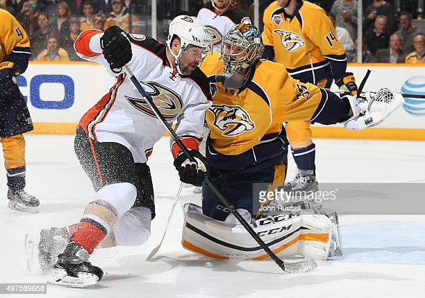 Pekka Rinne of the Nashville Predators gloves the puck away from Patrick Maroon of the Anaheim Ducks during an NHL game at Bridgestone Arena on...