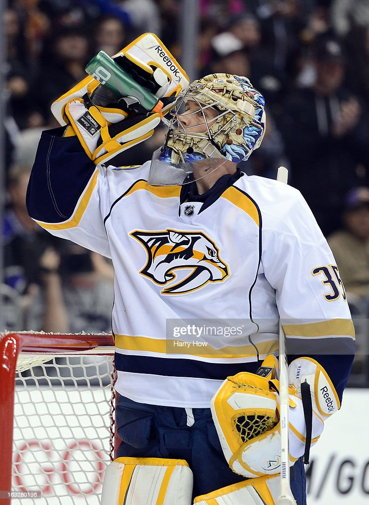 <a gi-track='captionPersonalityLinkClicked' href=/galleries/search?phrase=Pekka+Rinne&family=editorial&specificpeople=2118342 ng-click='$event.stopPropagation()'>Pekka Rinne</a> #35 of the Nashville Predators has a drink during a stop in play against the Los Angeles KingLos Angeles Kingsat Staples Center on March 4, 2013 in Los Angeles, California.