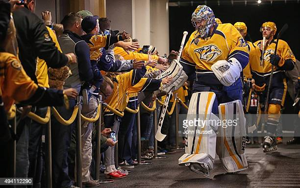 Pekka Rinne of the Nashville Predators leads the team to the ice against the Pittsburgh Penguins during an NHL game at Bridgestone Arena on October...