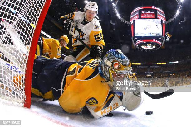 Pekka Rinne of the Nashville Predators makes a glove save against Jake Guentzel of the Pittsburgh Penguins during the second period in Game Four of...