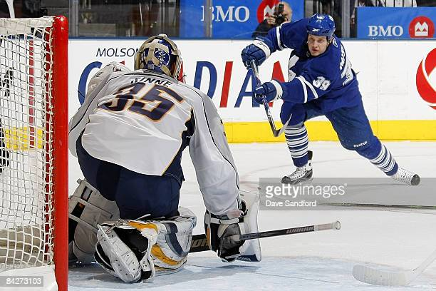 Pekka Rinne of the Nashville Predators makes a save against John Mitchell of the Toronto Maple Leafs during their NHL game at the Air Canada Centre...