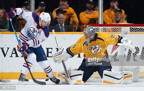 Pekka Rinne of the Nashville Predators makes a save against Taylor Hall of the Edmonton Oilers during an NHL game at Bridgestone Arena on October 10...