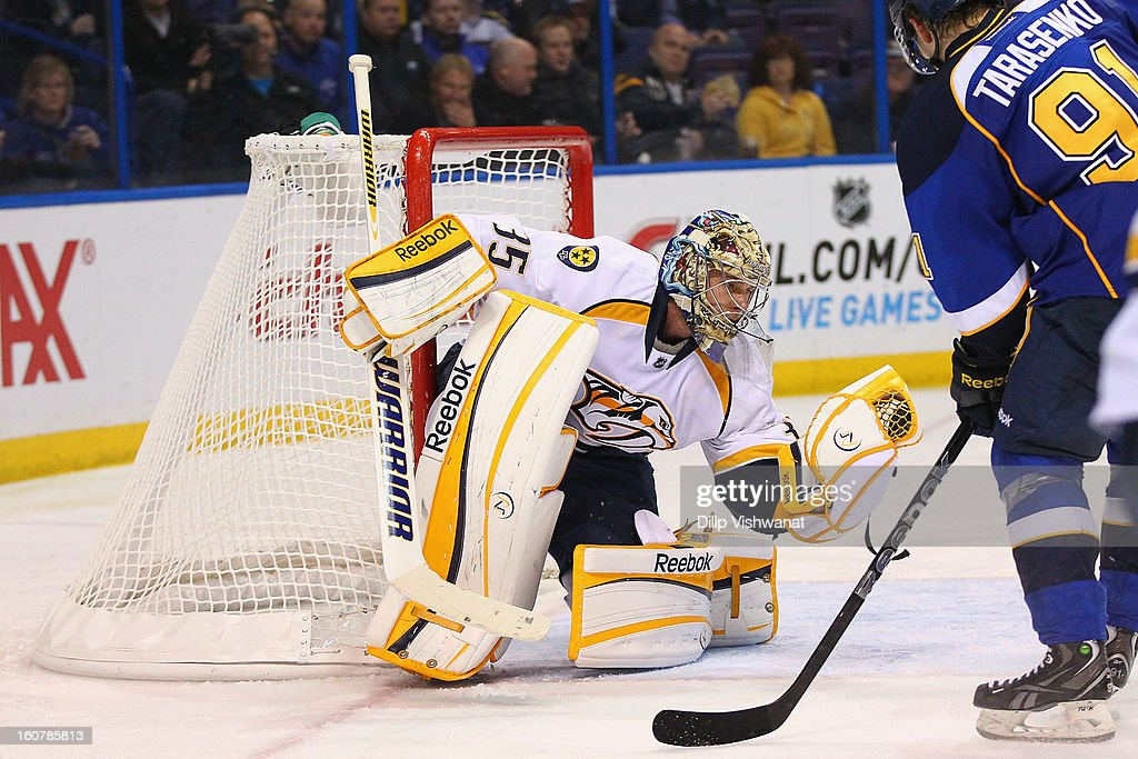 <a gi-track='captionPersonalityLinkClicked' href=/galleries/search?phrase=Pekka+Rinne&family=editorial&specificpeople=2118342 ng-click='$event.stopPropagation()'>Pekka Rinne</a> #35 of the Nashville Predators makes a save against the St. Louis Blues at the Scottrade Center on February 5, 2013 in St. Louis, Missouri.