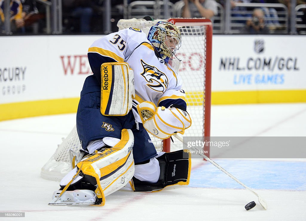 <a gi-track='captionPersonalityLinkClicked' href=/galleries/search?phrase=Pekka+Rinne&family=editorial&specificpeople=2118342 ng-click='$event.stopPropagation()'>Pekka Rinne</a> #35 of the Nashville Predators makes a save off a shoot in during the second period against the Los Angeles Kings at Staples Center on March 4, 2013 in Los Angeles, California.