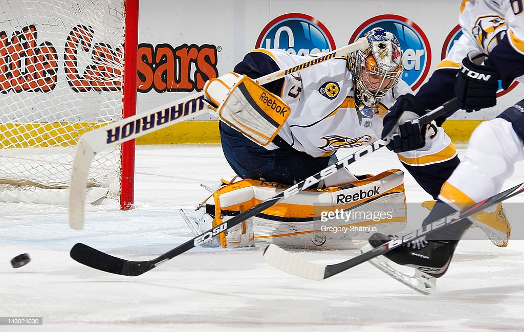 <a gi-track='captionPersonalityLinkClicked' href=/galleries/search?phrase=Pekka+Rinne&family=editorial&specificpeople=2118342 ng-click='$event.stopPropagation()'>Pekka Rinne</a> #35 of the Nashville Predators makes a save while playing the Detroit Red Wings in Game Four of the Western Conference Quarterfinals during the 2012 NHL Stanley Cup Playoffs at Joe Louis Arena on April 17, 2012 in Detroit, Michigan. Nashville won the game 3-1 and lead the series 3-1.