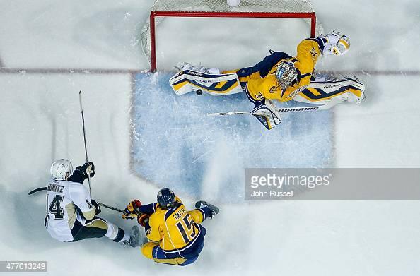Pekka Rinne of the Nashville Predators makes the save against Chris Kunitz of the Pittsburgh Penguins at Bridgestone Arena on March 4 2014 in...