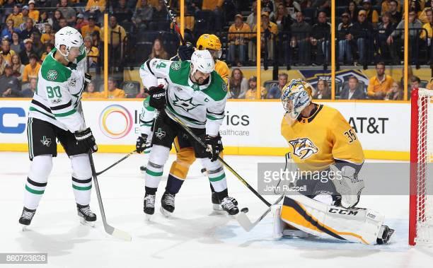 Pekka Rinne of the Nashville Predators makes the save against Jamie Benn of the Dallas Stars during an NHL game at Bridgestone Arena on October 12...