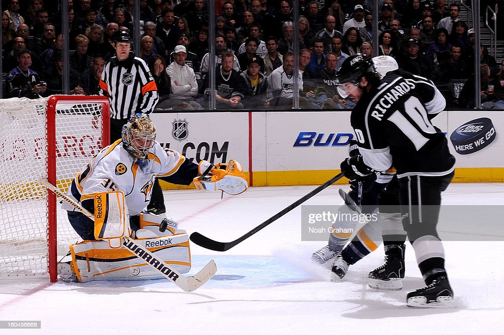 Pekka Rinne #35 of the Nashville Predators makes the save against Mike Richards #10 of the Los Angeles Kings at Staples Center on January 31, 2013 in Los Angeles, California.