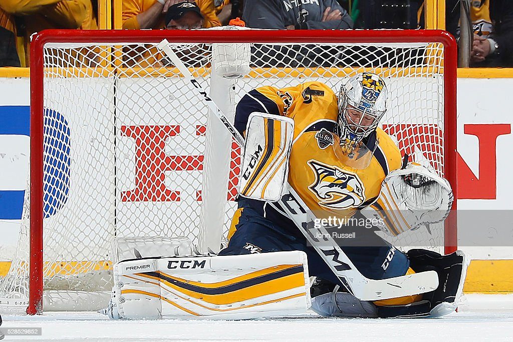 <a gi-track='captionPersonalityLinkClicked' href=/galleries/search?phrase=Pekka+Rinne&family=editorial&specificpeople=2118342 ng-click='$event.stopPropagation()'>Pekka Rinne</a> #35 of the Nashville Predators makes the save against the San Jose Sharks in Game Four of the Western Conference Second Round during the 2016 NHL Stanley Cup Playoffs at Bridgestone Arena on May 5, 2016 in Nashville, Tennessee.