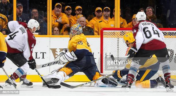 Pekka Rinne of the Nashville Predators makes the save against Tyson Barrie of the Colorado Avalanche during an NHL game at Bridgestone Arena on...