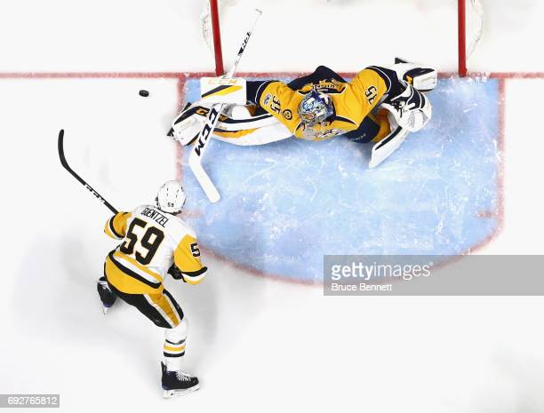 Pekka Rinne of the Nashville Predators makes the save on Jake Guentzel of the Pittsburgh Penguins in Game Four of the 2017 NHL Stanley Cup Final at...