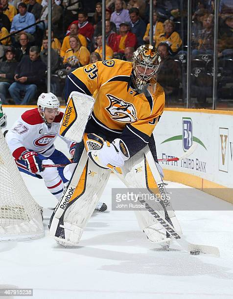 Pekka Rinne of the Nashville Predators plays the puck against the Montreal Canadiens during an NHL game at Bridgestone Arena on March 24 2015 in...