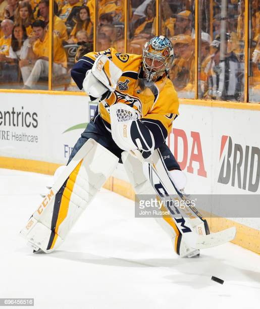 Pekka Rinne of the Nashville Predators plays the puck against the Pittsburgh Penguins during Game Three of the 2017 NHL Stanley Cup Final at...