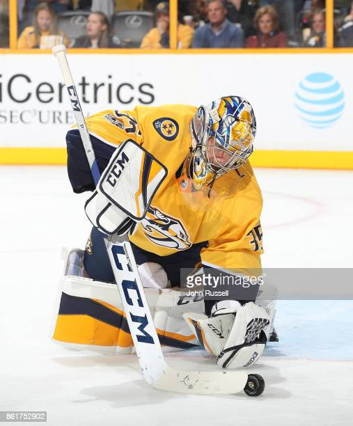 Pekka Rinne of the Nashville Predators plays the puck against the Dallas Stars during an NHL game at Bridgestone Arena on October 12 2017 in...