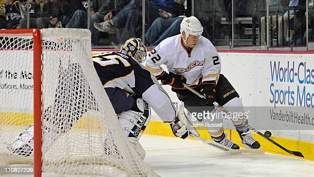 Pekka Rinne of the Nashville Predators poke checks the puck from Todd Marchant of the Anaheim Ducks during an NHL game on March 24 2011 at...