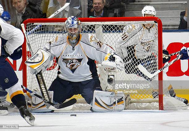 Pekka Rinne of the Nashville Predators prepares to make a save against the Toronto Maple Leafs during their NHL game at the Air Canada Centre January...