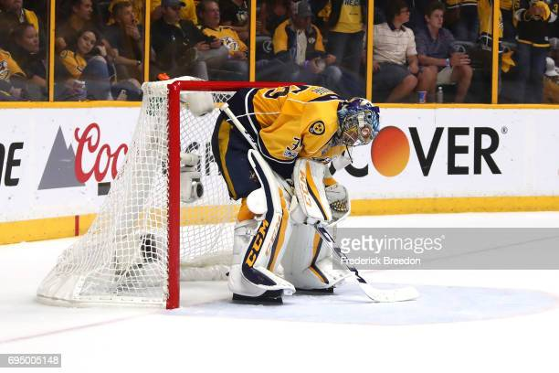 Pekka Rinne of the Nashville Predators reacts after the Pittsburgh Penguins scored a goal during the third period in Game Six of the 2017 NHL Stanley...