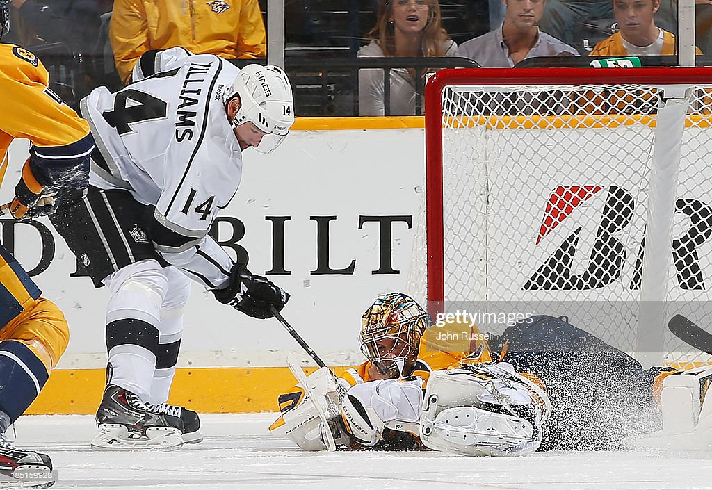 Pekka Rinne #35 of the Nashville Predators scrambles to make a save against Justin Williams #14 of the Los Angeles Kings at Bridgestone Arena on October 17, 2013 in Nashville, Tennessee.