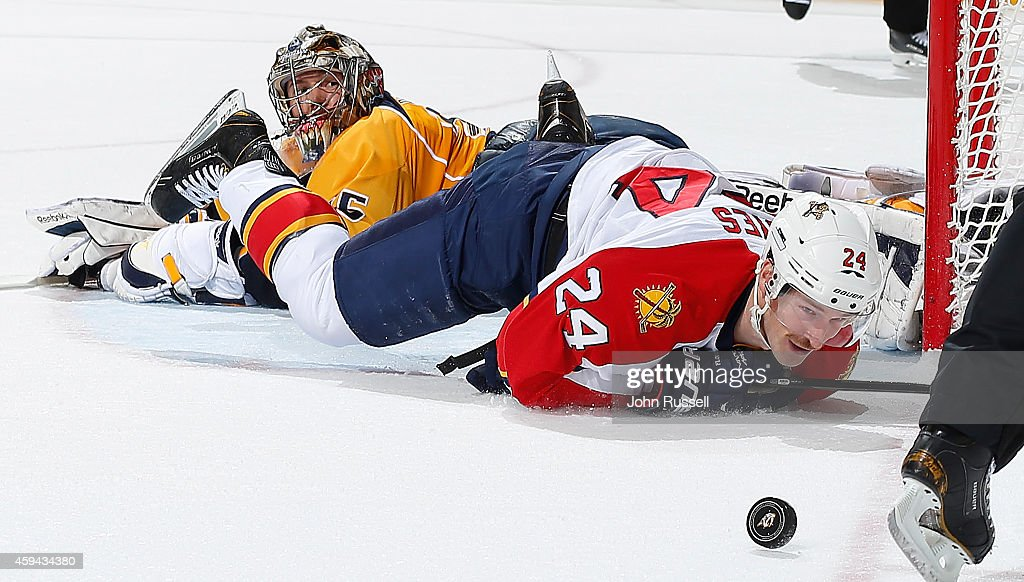 <a gi-track='captionPersonalityLinkClicked' href=/galleries/search?phrase=Pekka+Rinne&family=editorial&specificpeople=2118342 ng-click='$event.stopPropagation()'>Pekka Rinne</a> #35 of the Nashville Predators secures the shootout win against <a gi-track='captionPersonalityLinkClicked' href=/galleries/search?phrase=Brad+Boyes&family=editorial&specificpeople=275014 ng-click='$event.stopPropagation()'>Brad Boyes</a> #24 of the Florida Panthers at Bridgestone Arena on November 22, 2014 in Nashville, Tennessee.