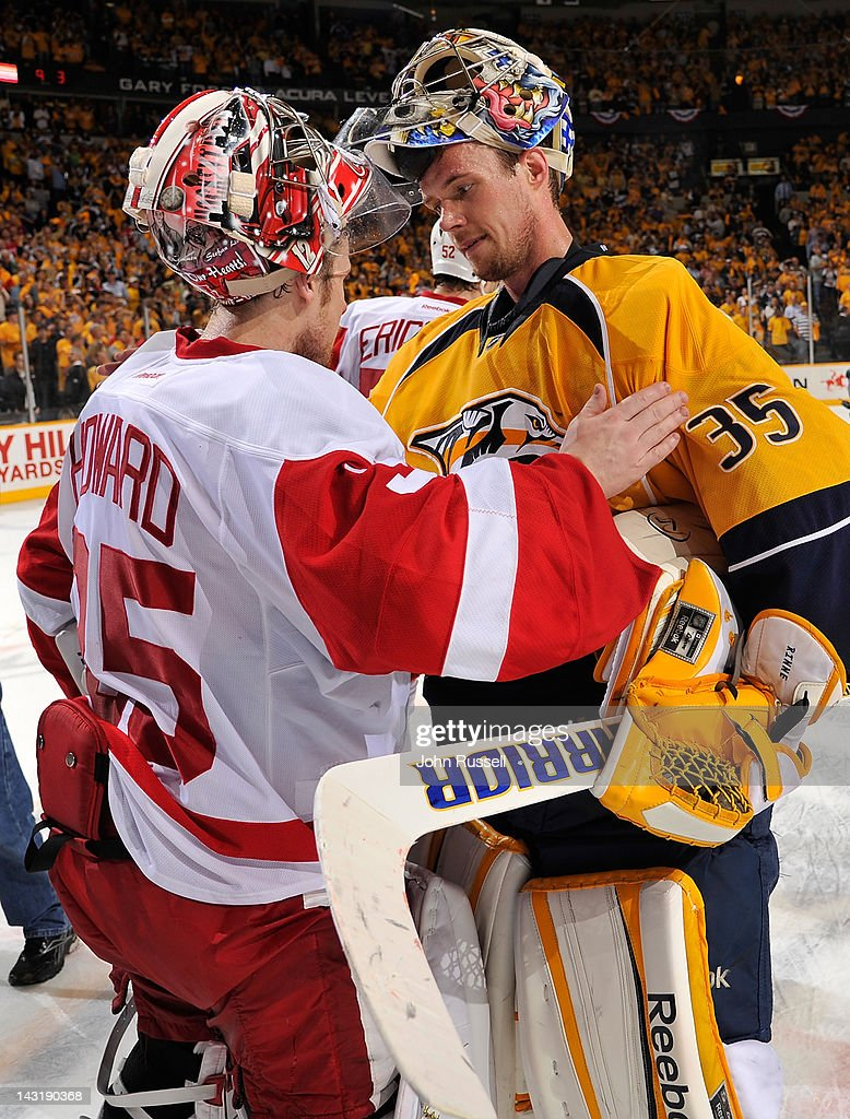 <a gi-track='captionPersonalityLinkClicked' href=/galleries/search?phrase=Pekka+Rinne&family=editorial&specificpeople=2118342 ng-click='$event.stopPropagation()'>Pekka Rinne</a> #35 of the Nashville Predators shakes hands with <a gi-track='captionPersonalityLinkClicked' href=/galleries/search?phrase=Jimmy+Howard&family=editorial&specificpeople=2118637 ng-click='$event.stopPropagation()'>Jimmy Howard</a> #35 of the Detroit Red Wings after Game Five of the Western Conference Quarterfinals during the 2012 NHL Stanley Cup Playoffs at the Bridgestone Arena on April 20, 2012 in Nashville, Tennessee.