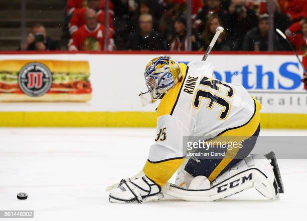 Pekka Rinne of the Nashville Predators slides out in front of the net to make a save against the Chicago Blackhawks at the United Center on October...