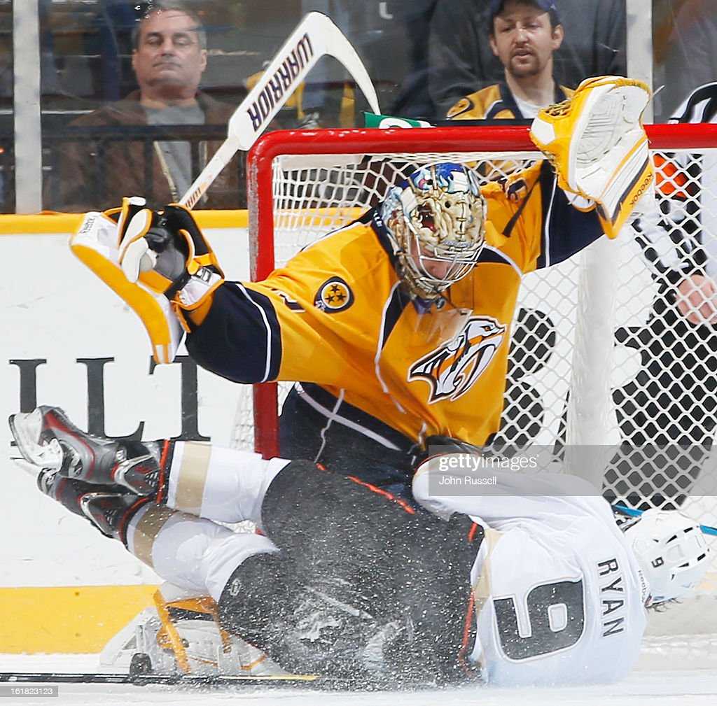 <a gi-track='captionPersonalityLinkClicked' href=/galleries/search?phrase=Pekka+Rinne&family=editorial&specificpeople=2118342 ng-click='$event.stopPropagation()'>Pekka Rinne</a> #35 of the Nashville Predators stops the puck and <a gi-track='captionPersonalityLinkClicked' href=/galleries/search?phrase=Bobby+Ryan+-+Ice+Hockey+Player&family=editorial&specificpeople=877359 ng-click='$event.stopPropagation()'>Bobby Ryan</a> #9 of the Anaheim Ducks during an NHL game at the Bridgestone Arena on February 16, 2013 in Nashville, Tennessee.