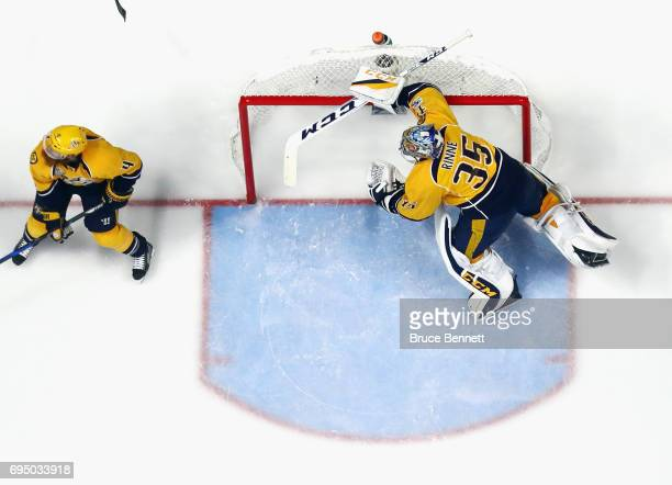 Pekka Rinne of the Nashville Predators stubbles getting back into the net against the Pittsburgh Penguins in Game Six of the 2017 NHL Stanley Cup...