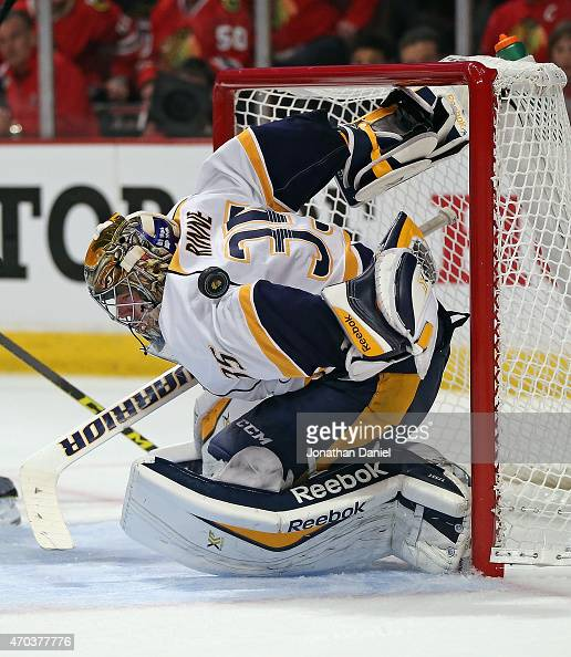 Pekka Rinne of the Nashville Predators takes a puck off of his shoulder against the Chicago Blackhawks in Game Three of the Western Conference...