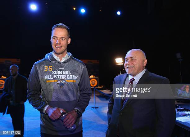 Pekka Rinne of the Nashville Predators talks with Head Coach Barry Trotz of the Washington Capitals speaks during Media Day for the 2016 NHL AllStar...
