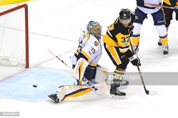 Pekka Rinne of the Nashville Predators tends goal against Carter Rowney of the Pittsburgh Penguins in the first period in Game Five of the 2017 NHL...