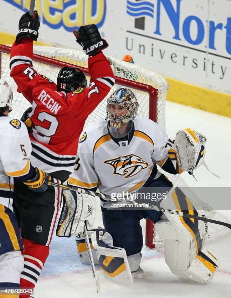 Pekka Rinne of the Nashville Predators watches as Peter Regin of the Chicago Blackhawks celebrates a third period goal at the United Center on March...
