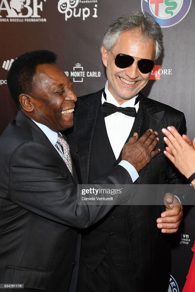 Pele and <a gi-track='captionPersonalityLinkClicked' href=/galleries/search?phrase=Andrea+Bocelli&family=editorial&specificpeople=211558 ng-click='$event.stopPropagation()'>Andrea Bocelli</a> walk the red carpet of Bocelli and Zanetti Night on May 25, 2016 in Rho, Italy.