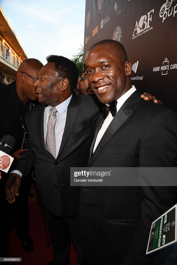Pele and <a gi-track='captionPersonalityLinkClicked' href=/galleries/search?phrase=Clarence+Seedorf&family=editorial&specificpeople=208215 ng-click='$event.stopPropagation()'>Clarence Seedorf</a> walk the red carpet of Bocelli and Zanetti Night on May 25, 2016 in Rho, Italy.