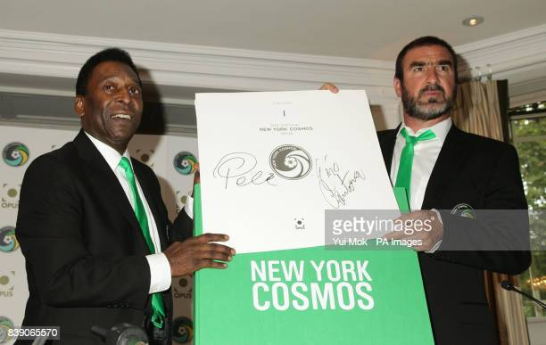 Pele and Eric Cantona after putting their signatures to the first copy of the Official New York Cosmos Opus book which weighs 37 kilos and contains...