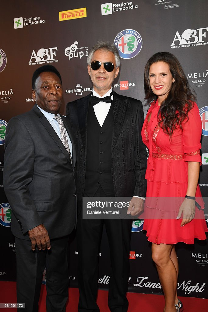Pele, <a gi-track='captionPersonalityLinkClicked' href=/galleries/search?phrase=Andrea+Bocelli&family=editorial&specificpeople=211558 ng-click='$event.stopPropagation()'>Andrea Bocelli</a> and Veronica Berti walk the red carpet of Bocelli and Zanetti Night on May 25, 2016 in Rho, Italy.