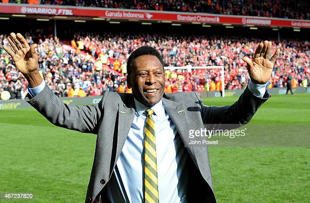 Pele comes onto the pitch at half time of the Barclays Premier League match between Liverpool and Manchester Untied at Anfield on March 22 2015 in...