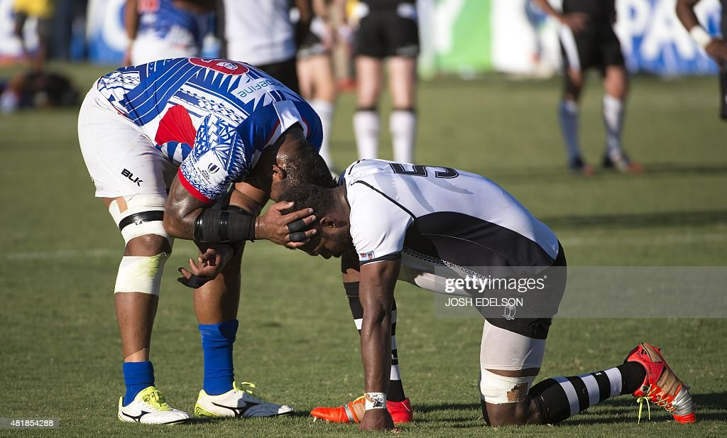 Pele Cowley of the Samoan national rugby team shares a moment with Fiji national rugby team player Leon Nakarawa during a World Rugby Pacific Nations...
