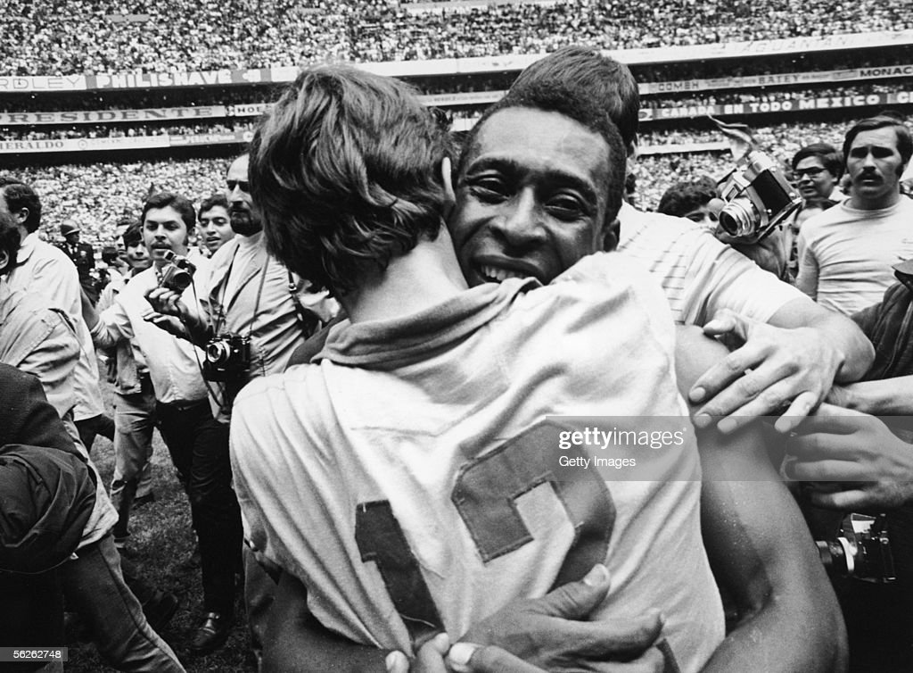 Pele embraces Brazilian goalkeeper Ado at the Estadio Azteca, in Mexico City, after Brazil beat Italy 4-1 to win the World Cup, 21st June 1970. Pele scored the first goal in a game that ensured Brazil kept the Jules Rimet trophy.